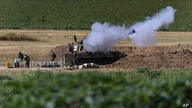An Israeli artillery unit fires toward targets in Gaza Strip, at the Israeli Gaza border, Tuesday, May 18, 2021. (AP Photo…
