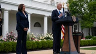 Vice President Kamala Harris listens as President Joe Biden speaks on updated guidance on mask mandates, in the Rose Garden of…