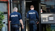 Police officers walk outside an apartment building cordoned off, in Brondby Strand, Copenhagen, Denmark, Thursday, Sept. 21,…