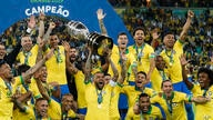 Brazil's Dani Alves lifts up his team's trophy after winning the final soccer match of the Copa America against Peru at the…