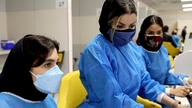 Medical personnel prepare Sinopharm vaccine shots for COVID-19 at the Iran Mall shopping center in Tehran, Iran, Monday, May 17…