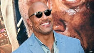 "FILE - In this July 10, 2018, file photo, Actor Dwayne Johnson attends the ""Skyscraper"" premiere in New York. George Clooney…"