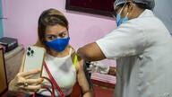 A woman takes selfie as she receives the Covishield vaccine against COVID-19 in Gauhati, Assam, India, Monday, May 17, 2021. …