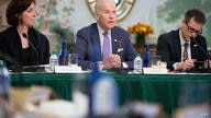 Vice President Joe Biden, center, flanked by Assistant Secretary of State for Western Hemisphere Affairs Roberta Jacobson, left…