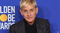 FILE - Ellen DeGeneres, winner of the Carol Burnett award, poses in the press room at the 77th annual Golden Globe Awards on…