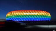 FILE - In this Saturday, July 9, 2016 file photo Munich's stadium is illuminated in rainbow colors on the occasion of…