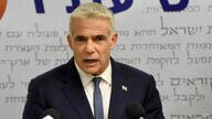 Chairman of the Yesh Atid Party, Yair Lapid, delivers a statement to the press in the Knesset, the Israeli Parliament, in…