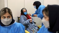 A woman receives the Sinopharm COVID-19 vaccine at the Iran Mall shopping center in Tehran, Iran, Monday, May 17, 2021. Last…