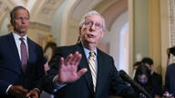Senate Minority Leader Mitch McConnell, R-Ky., joined at left by Minority Whip John Thune, R-S.D., talks with reporters before…