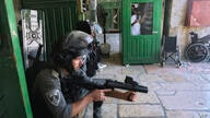 Israeli security forces take positions during clashes with Palestinians in front of the Dome of the Rock Mosque at the Al Aqsa…