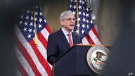 Attorney General Merrick Garland speaks at the Justice Department in Washington, on Tuesday, June 15, 2021. (Win McNamee/Pool…