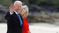 U.S. President Joe Biden and first lady Jill Biden wave during arrivals for the G7 meeting at the Carbis Bay Hotel in Carbis…