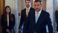 Sen. Ted Cruz, R-Texas, heads to the floor as the Senate prepares for a key test vote on the For the People Act, a sweeping…