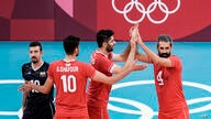 Iran's team players celebrate a point during the men's volleyball preliminary round pool A match between Iran and Venezuela at…