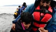 Afghan migrants arrive with a dinghy at the village of Skala Sikaminias, on the Greek island of Lesbos, after crossing the…