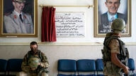 A Russian military policeman, left, rests in the lobby of a hospital in the city of Deir el-Zour, Syria, Friday, Sept. 15, 2017…