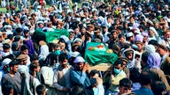 Afghans carry the body of civilians killed during fighting between the Taliban and Security forces, during their funeral, in…