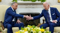 President Joe Biden, right, shakes hands with Iraqi Prime Minister Mustafa al-Kadhimi, left, during their meeting in the Oval…