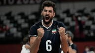 Iran's Seyed Mohammad Mousavi Eraghi celebrates his team's 3-2 victory over Poland at the end of their men's volleyball…
