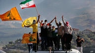 Hezbollah supporters wave their group, Iranian and Palestinian flags, during a protest in solidarity with Palestinians amid an…
