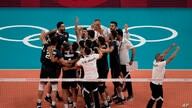 Iran's teammates celebrate their 3-2 victory over Poland at the end of a men's volleyball preliminary round pool A match, at…