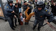 Police officers detain political activist Roman Dobrokhotov during the unauthorized meeting to mark Russian President Vladimir…