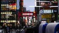The entrance to Kabukicho, Tokyo's entertainment district, is seen from a bus ahead of the 2020 Summer Olympics, Monday, July…