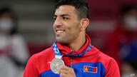 Saeid Mollaei of Mongolia celebrates with his silver medal during the award ceremony for the men -81kg judo match at the 2020…