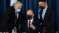 Israel's Prime Minister Naftali Bennett, center, and Israeli Foreign Minister Yair Lapid, left, attend the weekly cabinet…