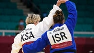 Tahani Alqahtani of Saudi Arabia, left, and Raz Hershko of Israel react after competing in their women's +78kg elimination…