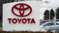FILE - In this Sunday, March 21, 2021 file photo, The company logo adorns a sign outside a Toyota dealership in Lakewood, Colo…