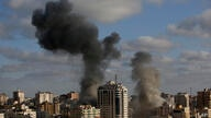 CORRECTS THE DATE AND BUILDING INFORMATION - An Israeli air strike hits a building in Gaza City, Monday, May 17, 2021. The…