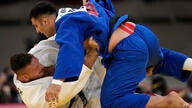 Javad Mahjoub of the Refugee Olympic Team, top, and Lukas Krpalek of the Czech Republic compete during their men's +100kg…