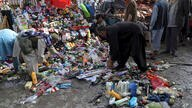 People inspect the site of a deadly bomb explosion in Kabul, Afghanistan, Tuesday, July 13, 2021. The bomb killed several…