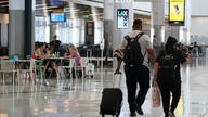 FILE - In this May 24, 2021, file photo, passengers wait for their flights inside the new West Gates at Tom Bradley…
