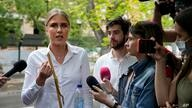 Russian opposition activist Lyubov Sobol speaks to the media was she arrives at the court in Moscow, Russia, Monday, Aug. 2,…
