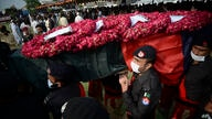 Police officers carry a casket of their colleague, who was killed in a grenade attack, during a funeral prayer, in Peshawar,…