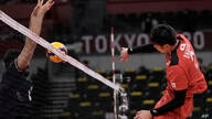 Japan's Taishi Onodera spikes a ball during a men's volleyball preliminary round pool A match against Iran, at the 2020 Summer…