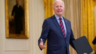 President Joe Biden turns back to answer a question after speaking about the coronavirus pandemic in the East Room of the White…