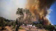An advancing fire engulfs Cokertme village, in Bodrum, Mugla, Turkey, Monday, Aug. 2, 2021. For the sixth straight day, Turkish…