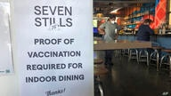 A proof of vaccination sign is posted at a bar in San Francisco on Thursday, July 29, 2021. Until now, many employers had taken…