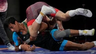 Iran's Mohammadali Geraei, left, compete against Hungary's Tamas Lorincz during the semi-final round of the men's 77kg Greco…