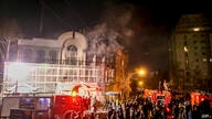 FILE -- In this Sunday, Jan. 3, 2016 file photo, smoke rises as Iranian protesters, upset over the execution of Shiite cleric…