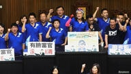 Lawmakers from the main opposition Kuomintang (KMT) party occupy the parliament to protest against the nomination of a close aide to the President to a top-level watchdog in Taipei