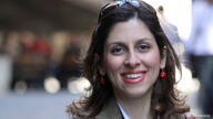FILE PHOTO: Iranian-British aid worker Nazanin Zaghari-Ratcliffe is seen in an undated photograph handed out by her family