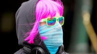 FILE PHOTO: FILE PHOTO: A person wears a scarf as a protective face mask in Melbourne, the first city in Australia to enforce mask-wearing to curb a resurgence of COVID-19