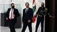 Lebanese Sunni leader Saad al-Hariri, walks after being named Lebanon's new prime minister at the presidential palace in Baabda