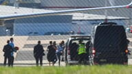 Passengers, including British-Australian academic Kylie Moore-Gilbert, disembark an Australian Government jet after arriving from the Middle East at Canberra Airport in Canberra