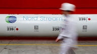 FILE PHOTO: The logo of the Nord Stream 2 gas pipeline project is seen on a pipe at Chelyabinsk pipe rolling plant in Chelyabinsk