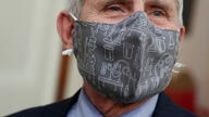 Fauci wears a lab equipment-themed mask as he arrives for a COVID-19 response event with U.S. President Biden at the White House in Washington